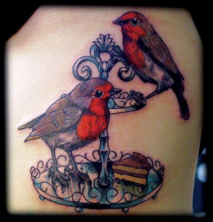 Dwa ptaki na kloszu tatuaż