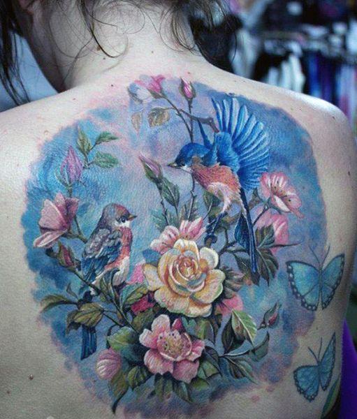 Kwiaty, ptaki i motyle tatuaż