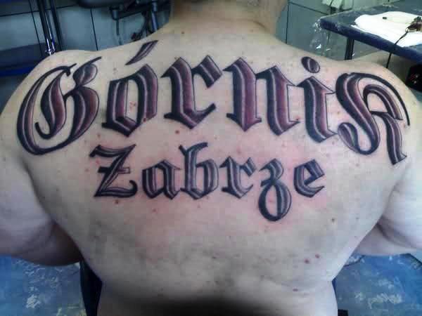 Napis Górnik Zabrze Tatuaż