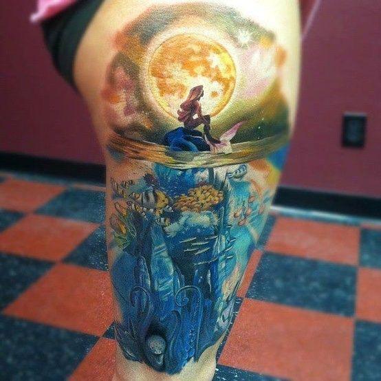 Tatuaż syrenka na skale