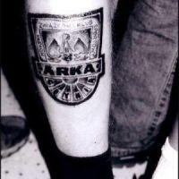 Herb Arka Gdynia tatuaż na nodze
