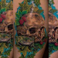 Czaszka i żaba wśród liści tatuaż