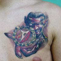 Diabeł z logo Widzew Łódź tatuaż