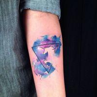 Jednorożec i tło  tatuaż