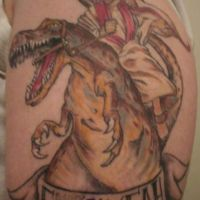 Jezus na dinozaurze tatuaż
