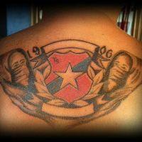 Kibice i logo Wisła Kraków tatuaż
