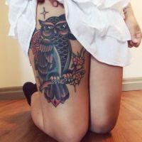 Sowa na gałęzi tatuaż