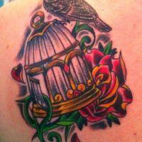 Tatuaż klatka dla ptaków i kwiat