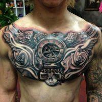 Tatuaż na klacie róże zegar czaszka