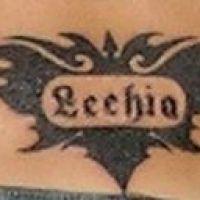 Tribal z napisem Lechia tatuaż