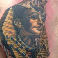 Złota głowa Faraona tatuaż