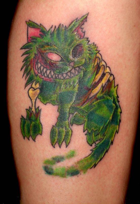 Zielony kotek tatuaż