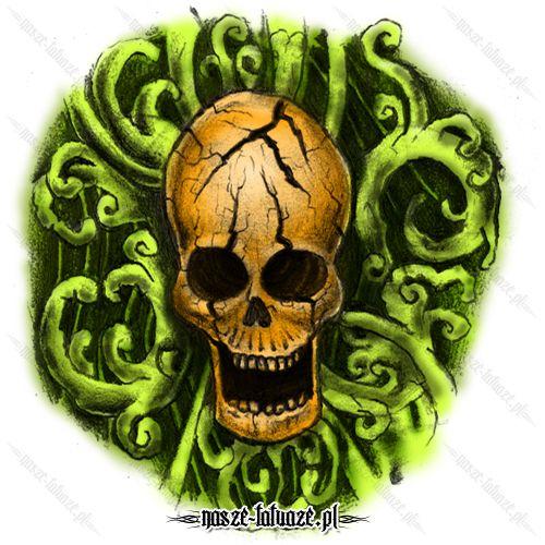 Złota czaszka na zielonych pnączach